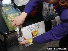 A woman pouring lemonade