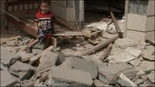 Toddler next to damaged building