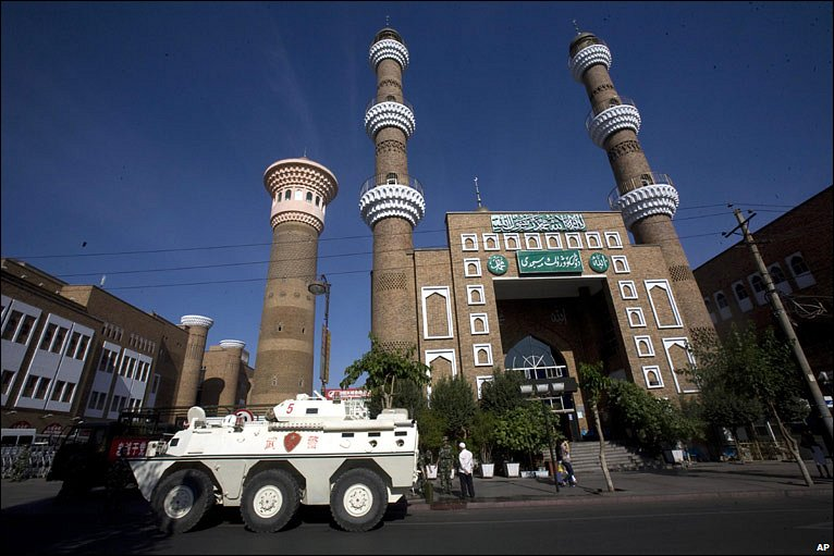 An armoured car parked outside a mosque in Urumqi