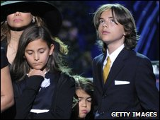 Paris Jackson, Prince Michael Jackson II and Prince Michael Jackson I stand onstage at the Michael Jackson public memorial service