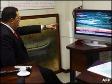 Venezuelan President Hugo Chavez watches TV in Caracas on 5 July 2009