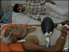 Men who consumed toxic liquor receive treatment at a hospital in Ahmedabad on July 9, 2009.