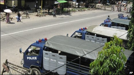 Police vehicles parked near Insein Prison, Burma, 10 July