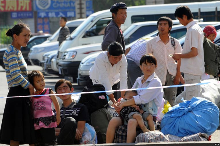 Passengers at the railway station in Urumqi on 10/7/09