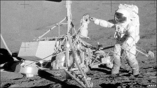 "Apollo 12 Mission Commander Charles ""Pete"" Conrad with surveyor craft on moon, photo taken by Alan Bean"