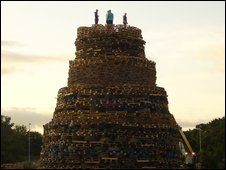 Huge bonefire with people standing on top