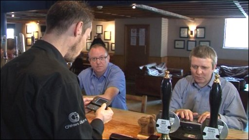 DeafBlind Communication device in operation in pub