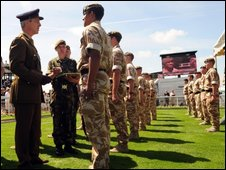 The soldiers receiving their medals