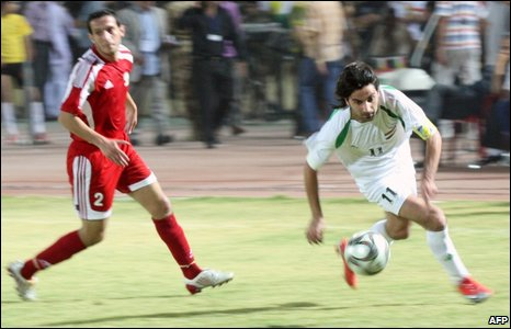 Palestine player Amar Abu Salil (L) vies for the ball against Iraqi player Hawar Mulla Muhammad in Irbil, 10 July