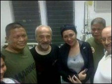 Former hostage Eugenio Vagni (with beard) after his liberation on Jolo Island, the Philippines, 11 July