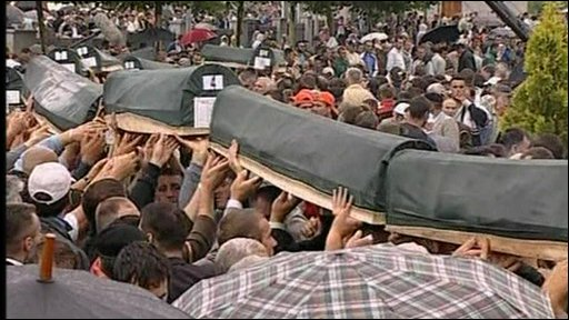 Coffins carried by crowds