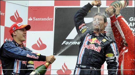 Mark Webber celebrates his maiden win