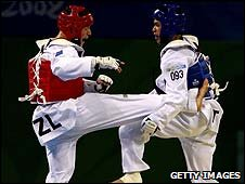 Logan Campbell (left) fights Sung Yu-Chi