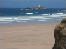 Upton Towans Beach and Godrevy lighthouse in Cornwall