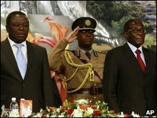 Zimbabwean Prime Minister Morgan Tsvangirai (left) and Zimbabwean President Robert Mugabe (right) attend the opening of the Zimbabwe Investment Conference in Harare, Thursday, on 9 July 2009