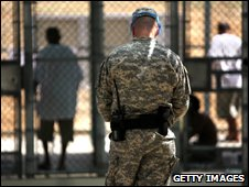 Guantanamo detainees and guard