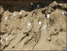 A photo from April 2002 showing a test trench dug by the group Physicians for Human Rights forensic as part of a preliminary investigation for the UN at the Dasht-e-Leili site near Sherberghan, Afghanistan, in which 15 bodies were exposed