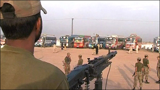 Soldier guarding buses