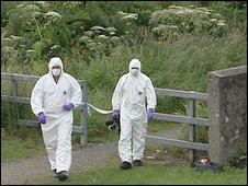 Forensic investigators at the murder scene in July 2009