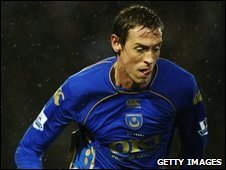 Portsmouth player Peter Crouch wearing the club's Canterbury made top