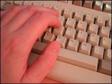 Hand on keyboard (generic)
