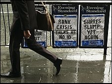 Evening Standard newsstand reads BANK CRISIS TALKS AT NO. 10 and SHARES SLUMP YET AGAIN