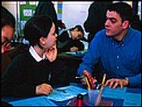 Junior school children and teacher in classroom