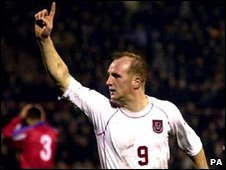 John Hartson after scoring for Wales