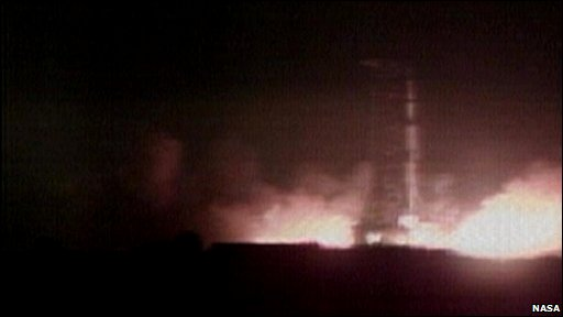 The Saturn V rocket conatining Apollo 17 taking off by night