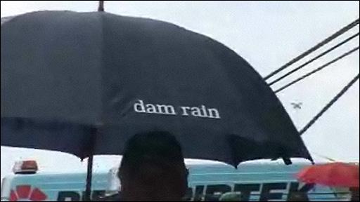 Passenger leaving cruise ship with umbrella