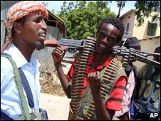 Somali insurgents patrol north Mogadishu on 13 July 2009