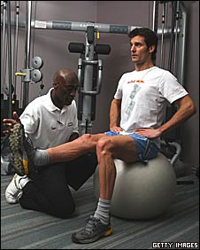 Mark Webber and his physio Roger Cleary work on  his broken right leg