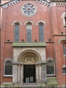 The ornate exterior of St Mary's Roman Catholic Church in Manchester