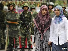 Uighur women and soldiers in Urumqi, 14 July