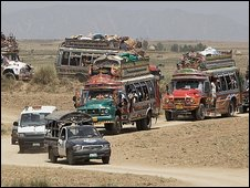 A convoy of buses carries displaced people back to the Swat valley, Pakistan