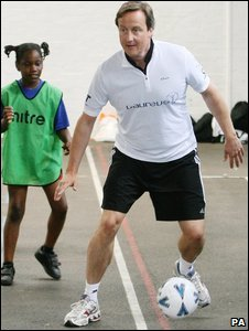 David Cameron playing football at Lilian Baylis Old School, Kennington, south London