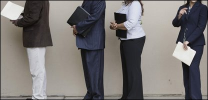 Job seekers line up at a careers fair