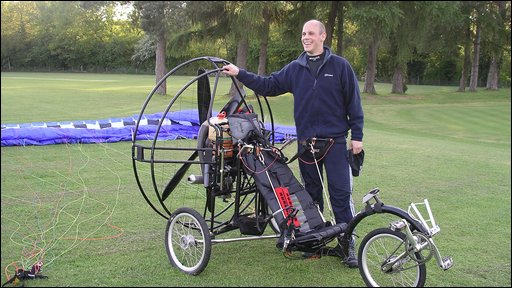 John Carver with his flying bicycle on the school playing field