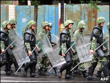 Armed Chinese soldiers patrol in Urumqi on July 15, 2009