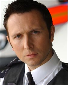 Inspector Smith, played by Alex Walkinshaw