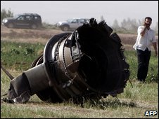 Part of the Caspian Airlines plane on farmland near Qazvin city, Iran, on 15 July 2009