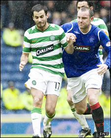 Marc Crosas and Kris Boyd tussle for the ball during an Old Firm game at Ibrox