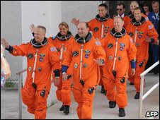 The seven crew, in their orange spacesuits, on 15 July