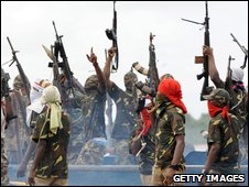 Members of Mend fire their weapons