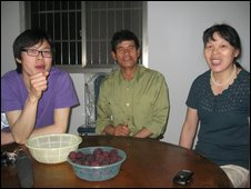 Colin Yu with his mother and father at their home in Yuyao village