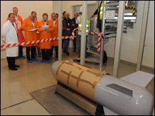 Engineers examine the fake bomb