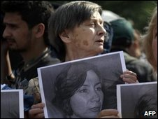 People hold portraits of Natalia Estemirova at a rally in Moscow, 16 July