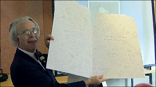 Professor Barry Hancock holding his leaving card