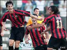 Flamurtari players celebrate scoring against Motherwell