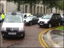 Taxis taking part in a protest